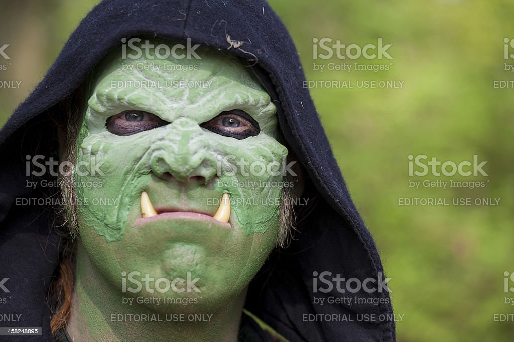 Man with green mask disguised as an ork stock photo