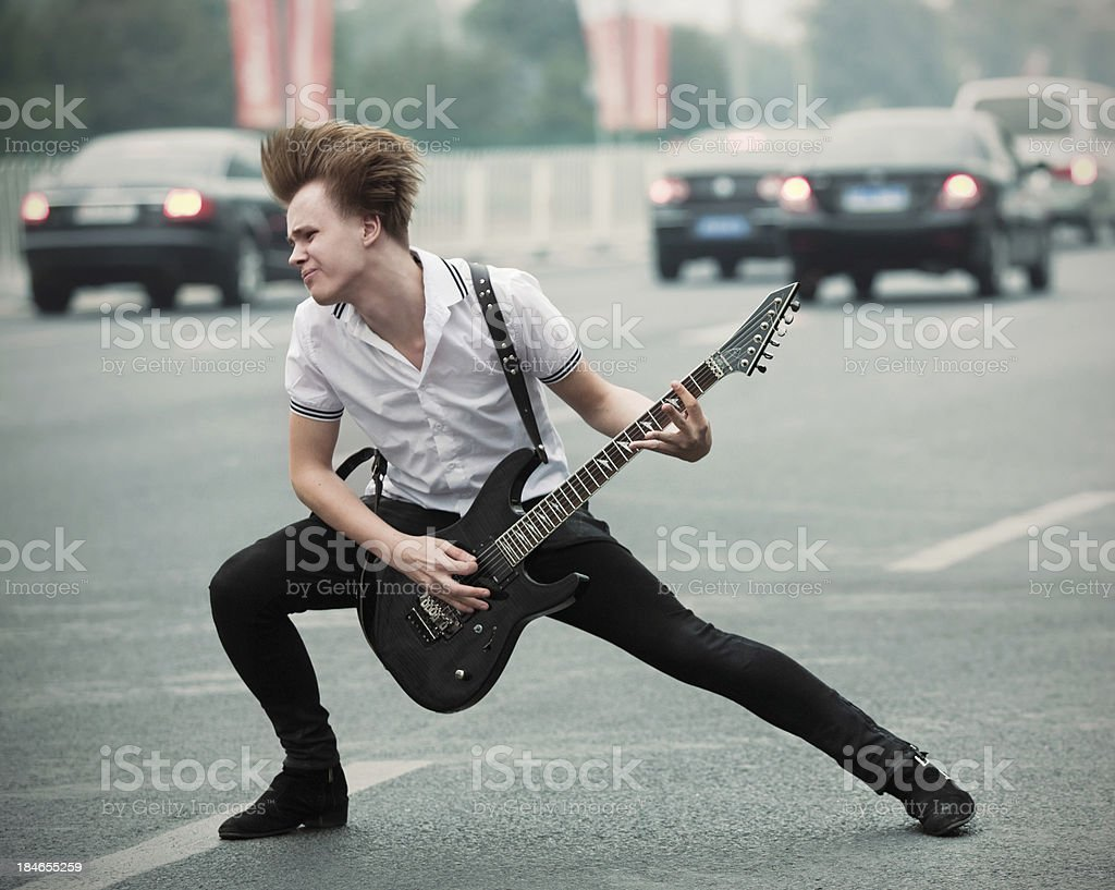 man with guitar on the road royalty-free stock photo