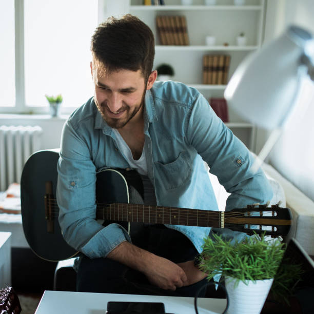 Man with guitar stock photo