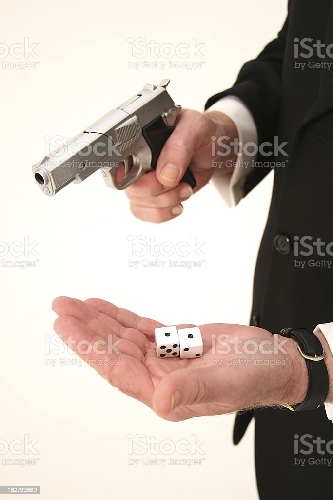 Man with gun and dice royalty-free stock photo