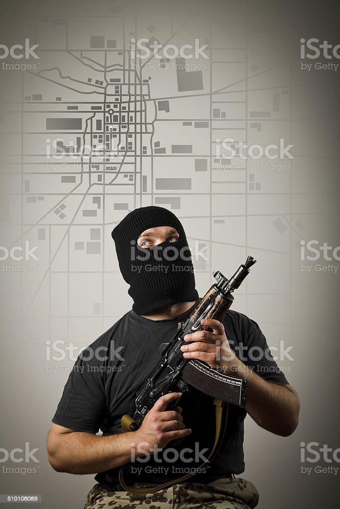 Man with gun. City map. stock photo