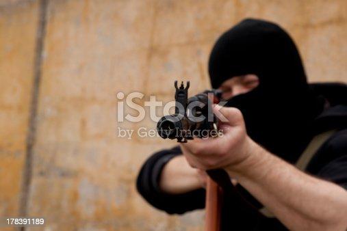 istock Man with gun 178391189
