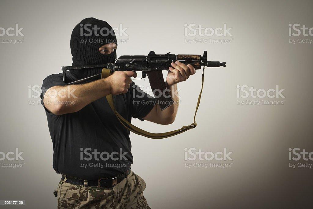 Man with gun stock photo