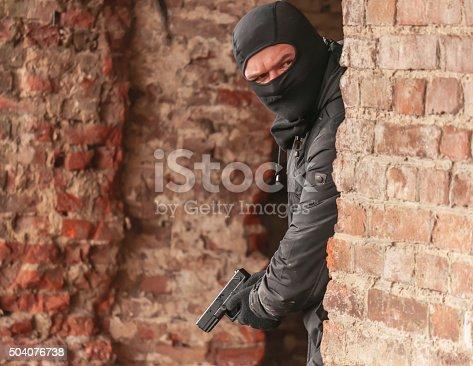 istock man with gun 504076738