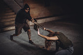 Snatch thief with gun stealing handbag from woman, Robber, Thief concept