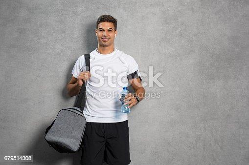istock Man with gym bag 679514308