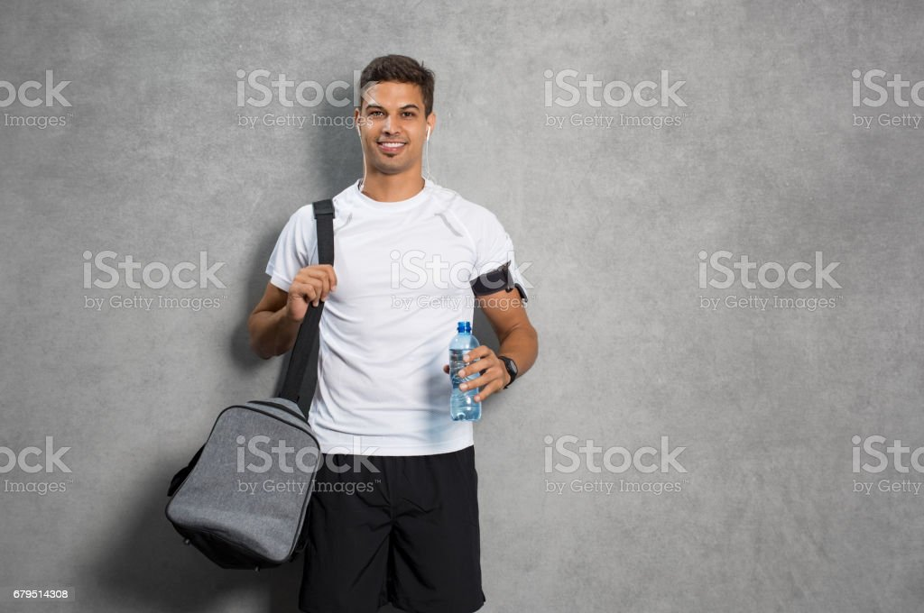 Man with gym bag stock photo