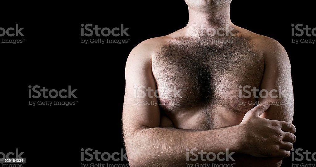 Man with hairy chest isolated on black background for text. stock photo