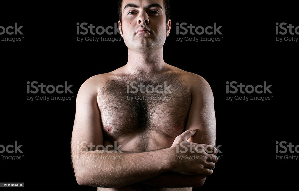 Man with hairy chest isolated on black background stock photo