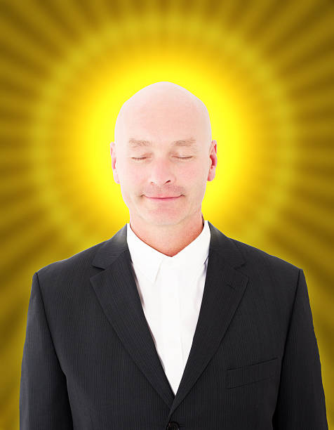 man with halo and eyes closed stock photo