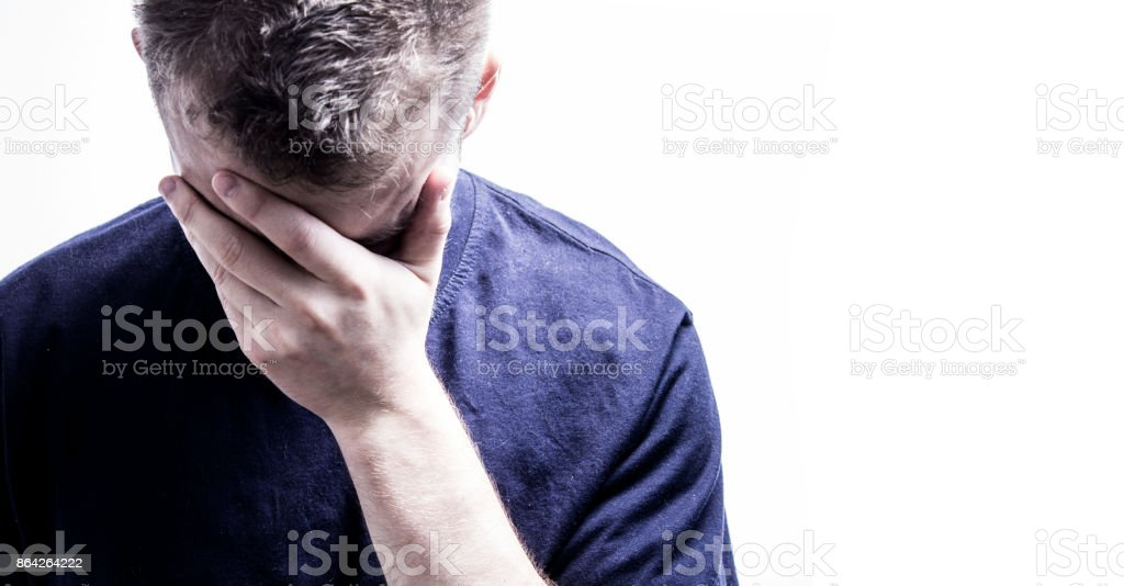 man with hand on face on white background feels ashamed royalty-free stock photo