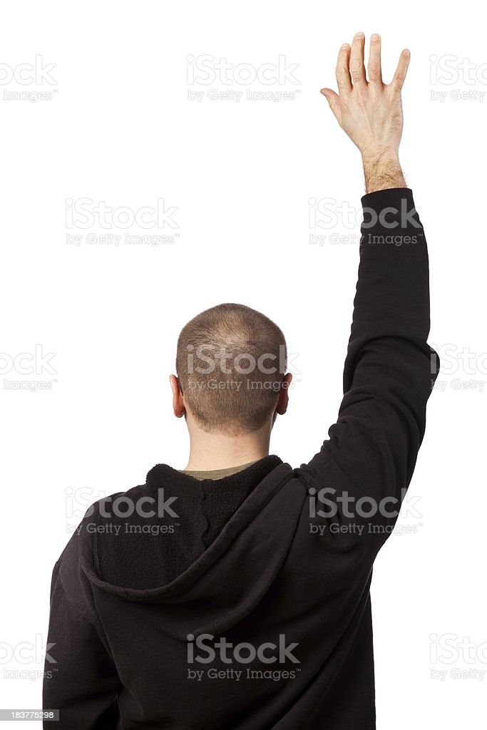 Man with hand raised royalty-free stock photo