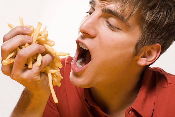 Man with handful of fries  handful stock pictures, royalty-free photos & images