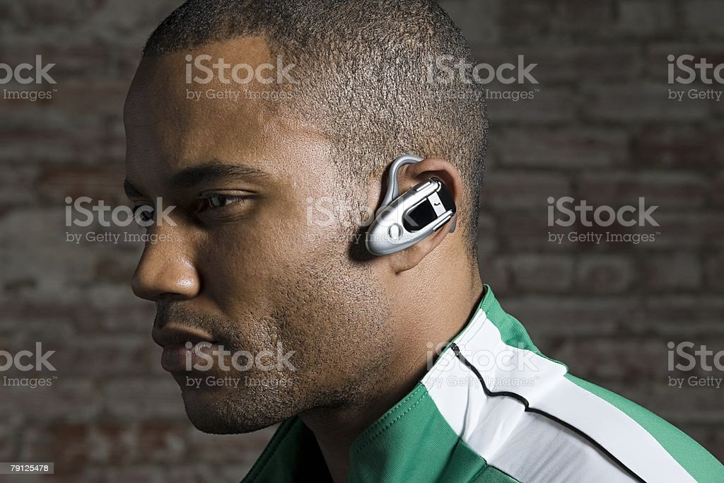 Man with hands free device royalty-free stock photo