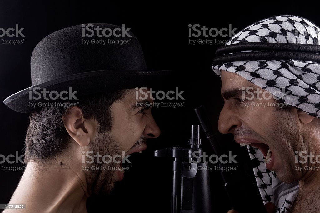 Man with hat and other in headscarf Confronting stock photo