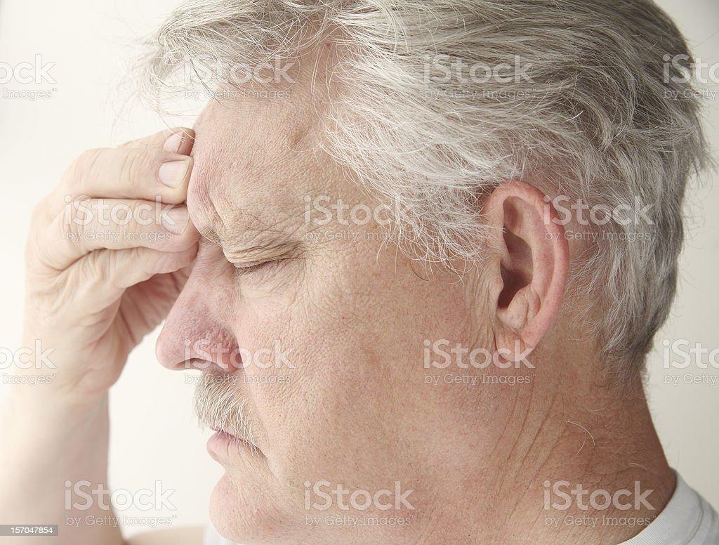 man with headache over eye royalty-free stock photo