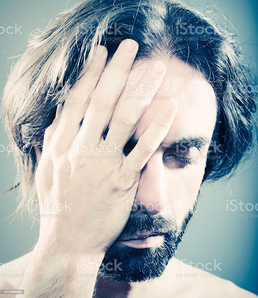Man with headache (migraine) royalty-free stock photo
