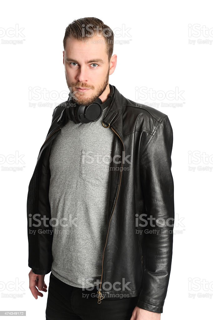 Man with headphones and a jacket stock photo