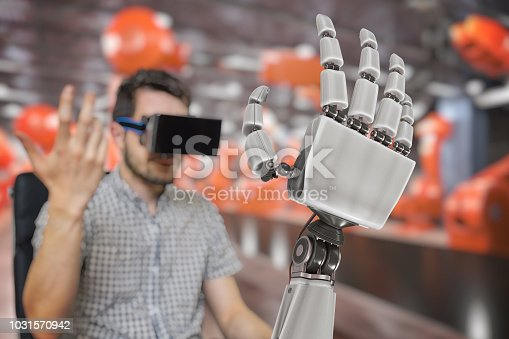 istock Man with headset is controlling robotic arm with his hand. 3D rendered illustration of robotic hand. 1031570942