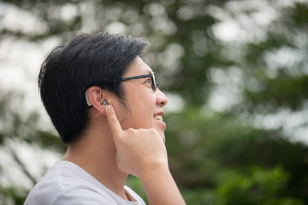 man with hearing aid behind the ear stock photo