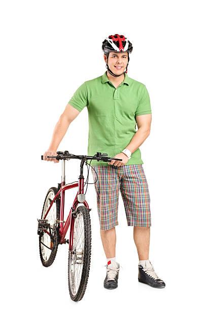 Man with helmet pushing a bike stock photo