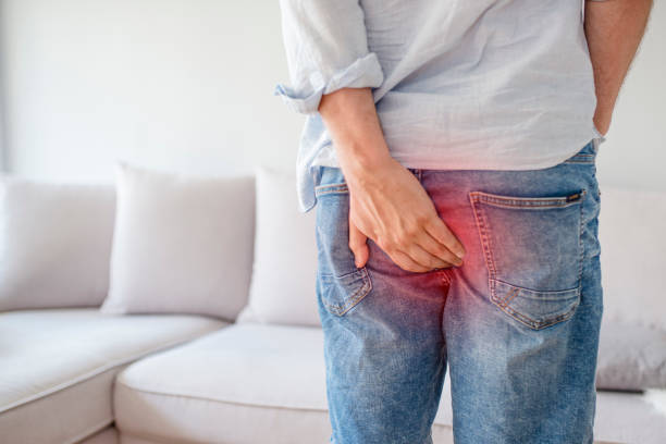 Man with hemorrhoids and constipation. stock photo