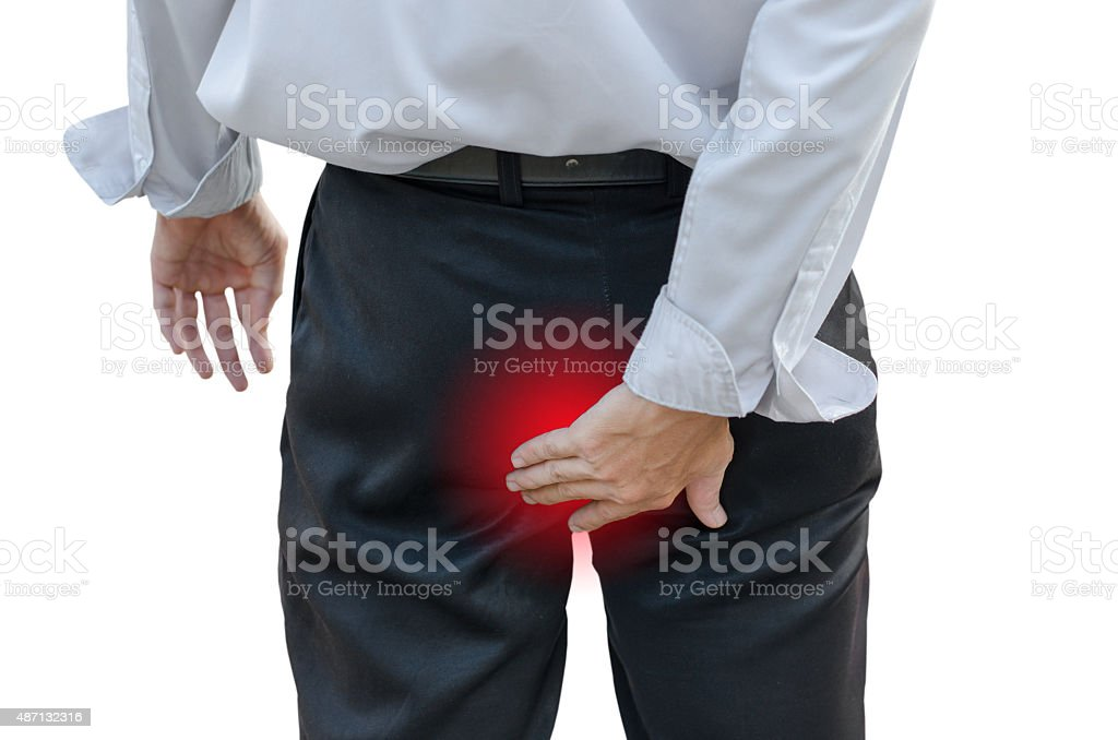 Man with hemorrhoids stock photo