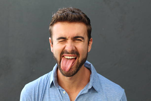 man with hilarious facial expression - tongue stock pictures, royalty-free photos & images