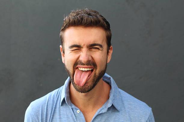 Man with hilarious facial expression stock photo