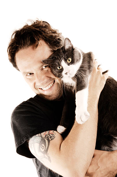man with his beloved cat stock photo