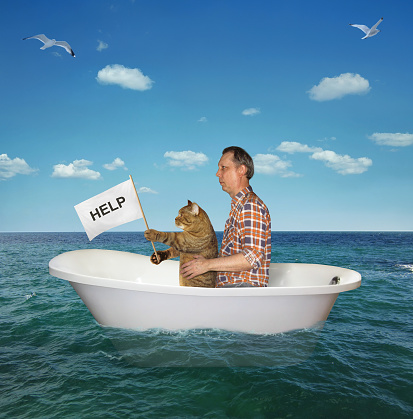 The man with his cat are drifting in a bathtub on the sea after a shipwreck. The cat holds a sign that says help.