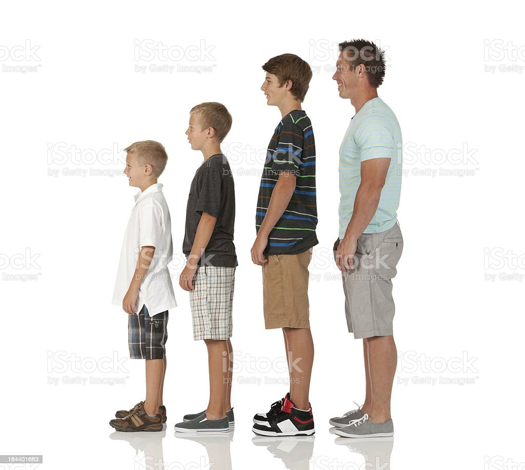 Man with his children standing in a row royalty-free stock photo