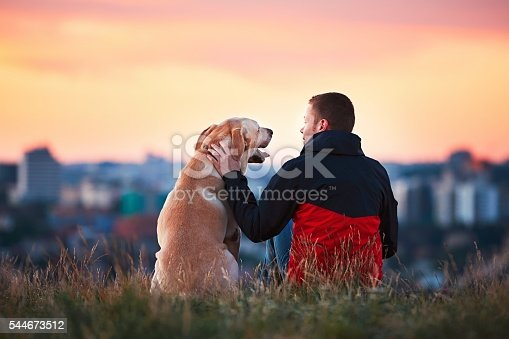 istock Man with his dog 544673512