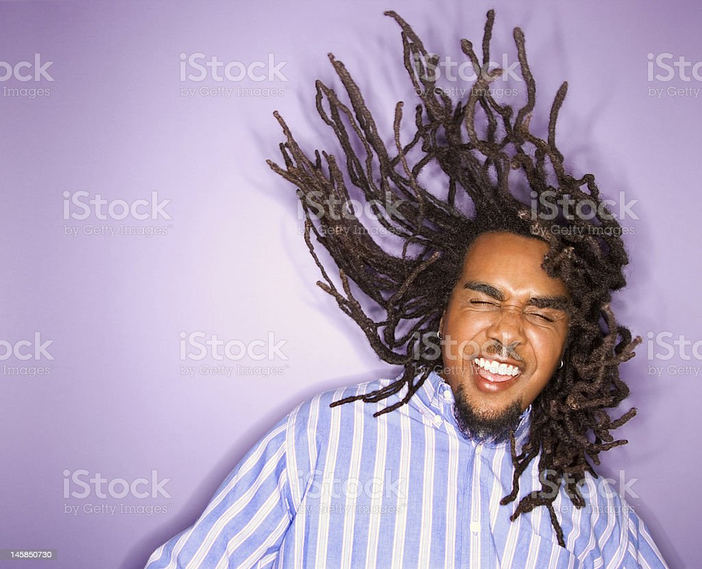 Man with his dreadlocks in motion. stock photo