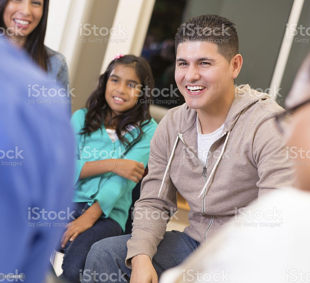 Man with his family in a discussion type meeting royalty-free stock photo