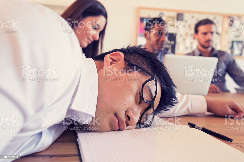Man with his head down in a meeting. stock photo