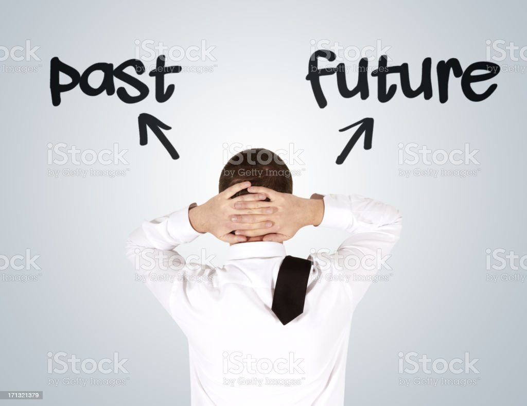 Man with his head in his hands with past & future arrows royalty-free stock photo