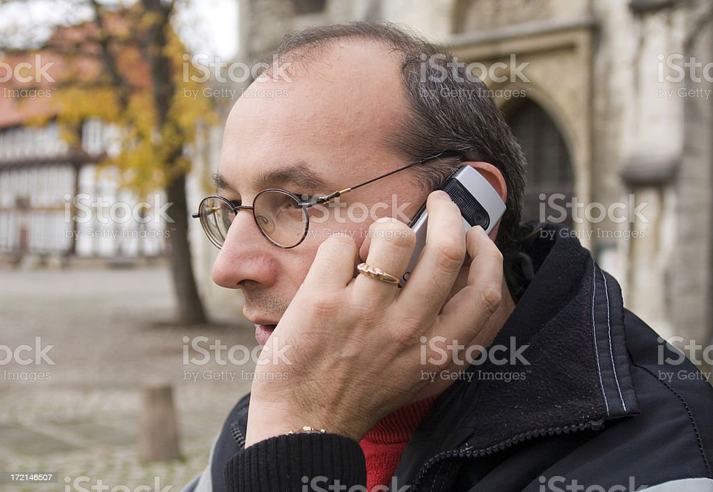 Man with his mobile phone royalty-free stock photo
