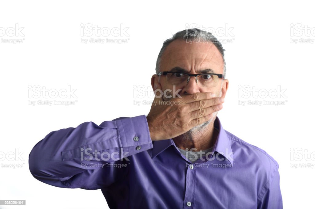 Man with his mouth covered stock photo