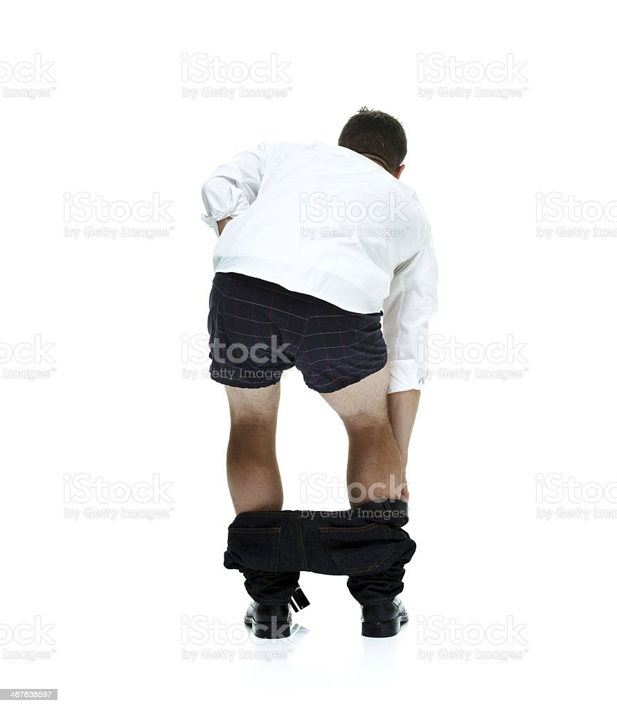 Man with his pants down stock photo
