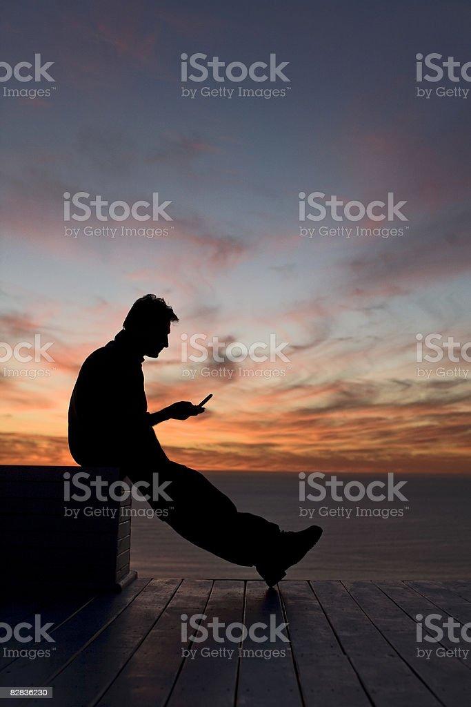 man with his phone zbiór zdjęć royalty-free