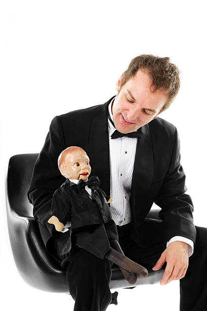 Man with his puppet Man interacting with his puppet ventriloquist's dummy stock pictures, royalty-free photos & images