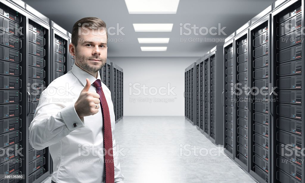 man with his right thumb up in server room stock photo