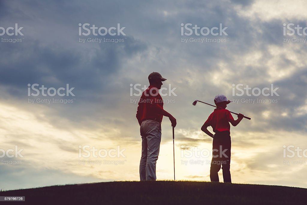 man with his son golfers - foto de stock