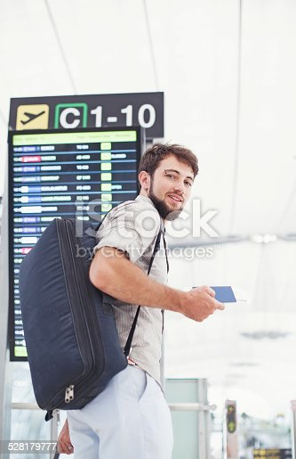 istock Man with his suitcase boarding in an airport 528179777