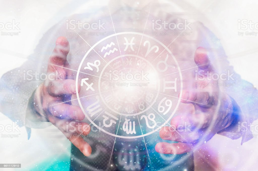 Man with horoscope circle in his hands - predictions of the future stock photo