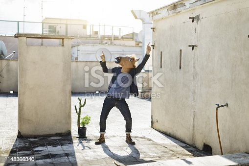 Man with horse head mask and trendy style
