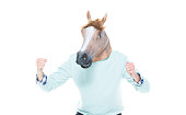 Man with horse mask wearing sweater and jeans
