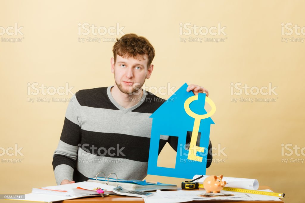 Man with house and key. royalty-free stock photo
