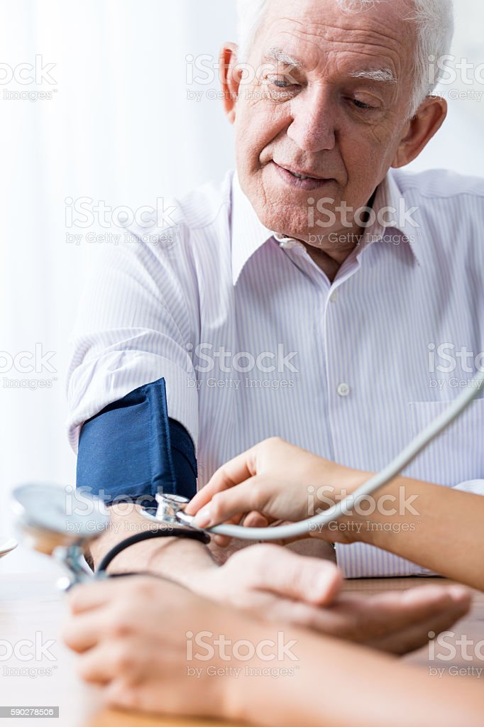 Man with hypertension and regular control stock photo